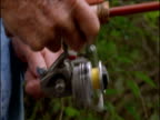 Fisherman winds fishing reel, USA