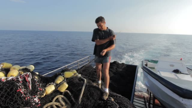 Fisherman working on the net