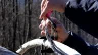 CU Fisherman's hands preparing fishing lure, Squamish, British Columbia, Canada