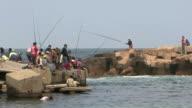 WS Fishermen and spectators on pier of Fort Qaitbay, Alexandria, Egypt