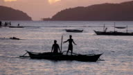 Fishermen at sunset, El Nido, Philippines