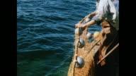 MONTAGE Fishermen bring in the catch in Brixham / United Kingdom