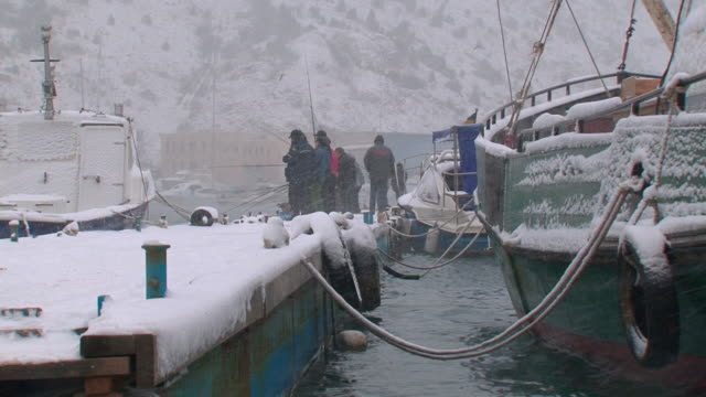 fishermen catch fish with a berth