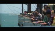 MS Fishermen fishing off pier