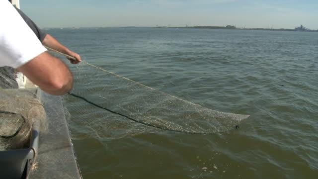Fishermen pull an empty net from the Chesapeake Bay