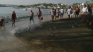 WS PAN Fishermen pulling net with fish in Acapulco Bay / Acapulco, Guerrero, Mexico