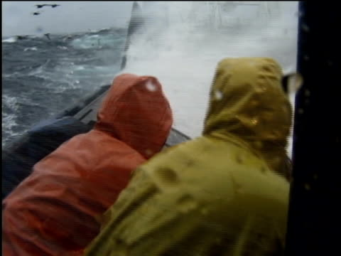 MS, SHAKY, Fishermen running on deck of ship, large wave crashing over side of boat, Bering Sea, Alaska, USA,