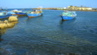 WS PAN Fishermen sitting in boat at red sea bay / Hurghada, Red Sea coast, Egypt