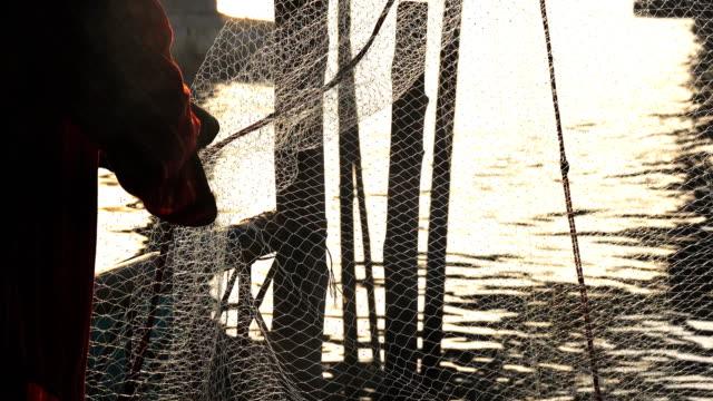 Fishermen Sorting fish in the net