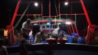 Fishermen transfer fish into baskets in preparation for an auction on a boat in the harbor in Puducherry India on Saturday July 19 Fishermen unload a...