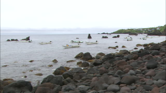 Fishermen troll in boats off the coast of Rishiri Island.