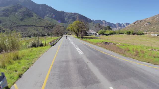 POV fisheye shot of biker travelling along mountain pass/ Western Cape/ South Africa