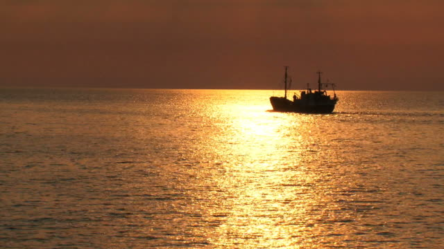 fishing boat at  golden  sunset