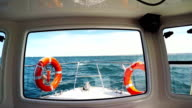 Fishing boat in rough sea POV