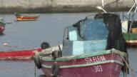 MS Fishing boat, man paddling in background, Antofagasta, Chile