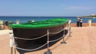 A fishing boat monument on the city beach of Portopalo di Capo Passero, Sicily