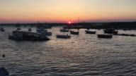 Fishing boats at the fishing port of Portopalo di Capo Passero, Sicily at sunset.