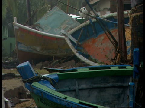 Fishing boats lie amongst debris following the 2004 Indian Ocean Tsunami