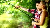 Fishing lesson at a lake.