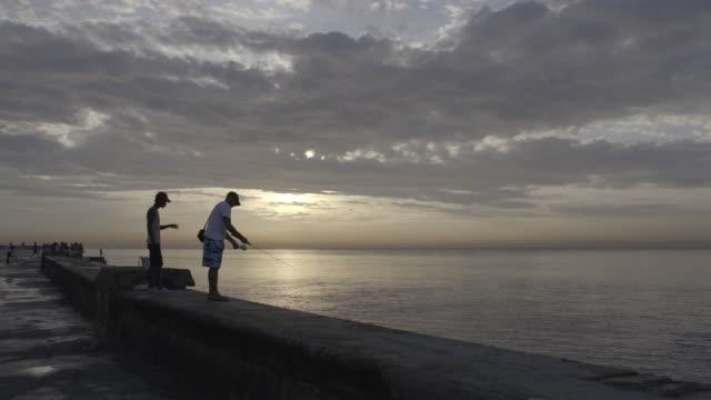 Fishing on pier at dusk