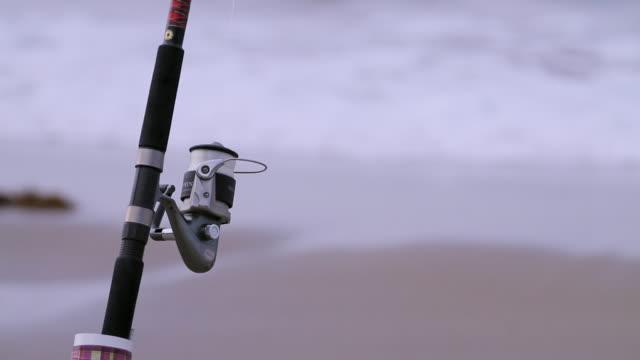C/U Fishing reel on beach