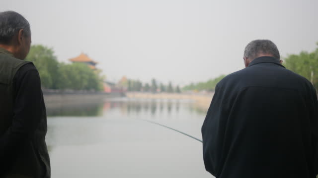 Fishing the in the moat of Forbidden City is no more than just killing spare time for the retirees in Beijing There are no matured fish in the moat