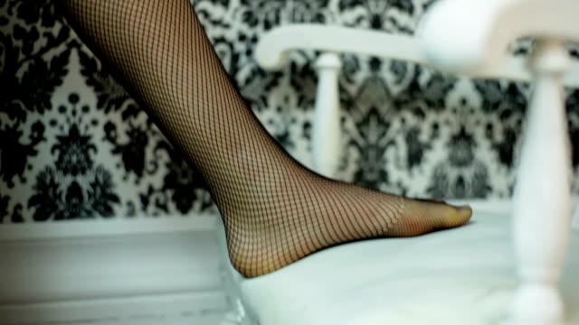 Calze a rete sulle gambe