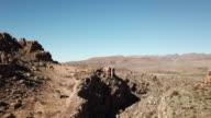 Fit male runs along an extreme mountain trail