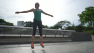 Fit woman doing jumping jacks