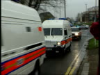 Five bomb plot suspects appear in court ITN London Belmarsh Magistrates court EXT Police vans towards escorted by police cars BV Police convoy away...
