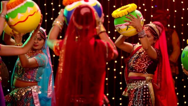 Five gujrati women performing garba, Delhi, India