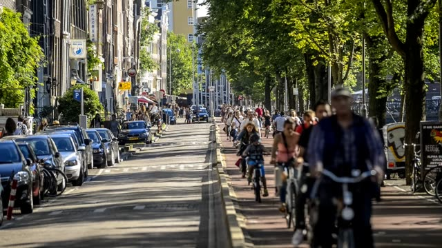 Five o'clock rush hour in Amsterdam, Gelderse kade. Commuters on bicycles riding back home after a work