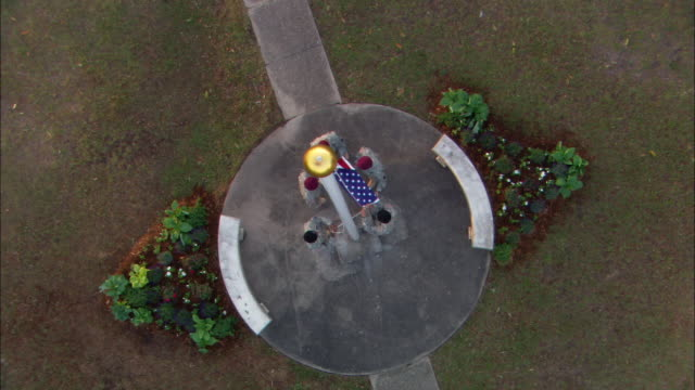 HA Five soldiers unfolding United States flag at base of flagpole / North Charleston, South Carolina, United States