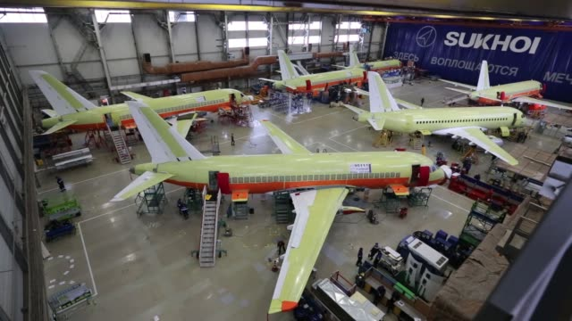 Five Sukhoi Superjet 100 aircraft sit in the Sukhoi Civil Aircraft Co final assembly plant in KomsomolskonAmur Russia on Wednesday Jan 27 The front...