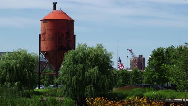 A flag flies half-mast in a Milwaukee Park