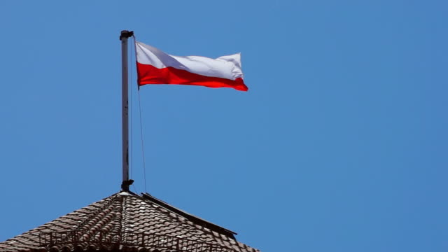 CU SLO MO flag of poland consists of two horizontal stripes of equal width, upper one white and lower one red / Krakow, poland