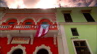 Flag of Puerto Rico hanging from balcony of building