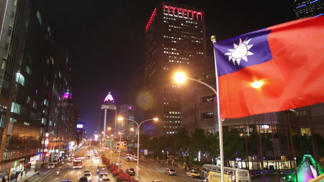 WS HA Flag of taiwan fluttering in downtown / Taipei, Taiwan