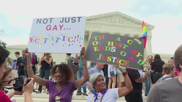 Flag waving LGBT rights advocates on the packed Supreme Court forecourt some in tears cheered danced shouted USA USA and sang The Star Spangled...