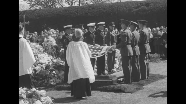VS flagfolding in front of flowerdraped casket by four Navy four Army officers / West Point cadets fire gun salute / VS officials and family at...