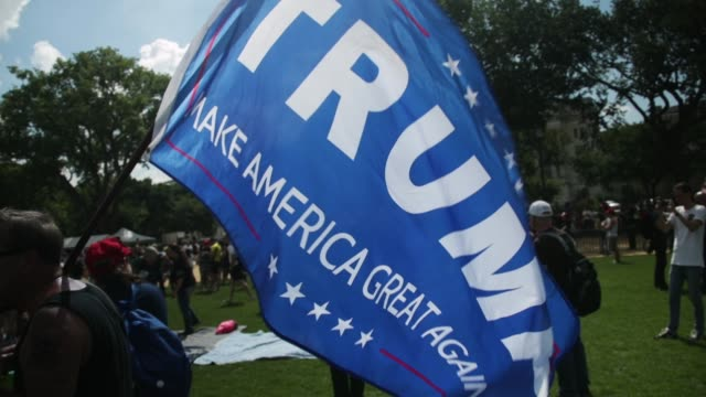 "Flags fly during a ""Mother of All Rallies"" September 16 2017 Hundreds of supporters of US President Donald Trump from around the country gather at..."