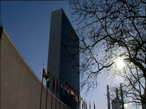 Flags flying outside United Nations building New York City