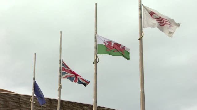 Flags lowered to halfmast outside the Welsh Assembly building after the suicide of Carl Sargeant