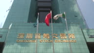 LA MS Flags waving in front of Shenzhen Stock Exchange/ Shenzhen, China