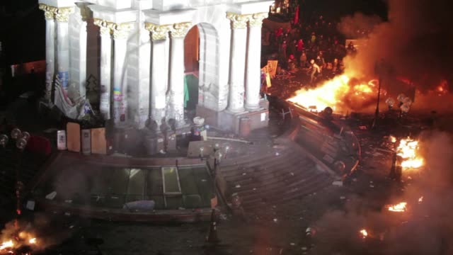 Flames engulf Kiev's occupied Independence Square as police storm the main protest camp in a bloody escalation of Ukraine's threemonth political...