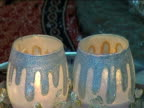 Flames in decorated candlesticks