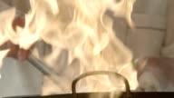 Flaming stir fry, slow motion