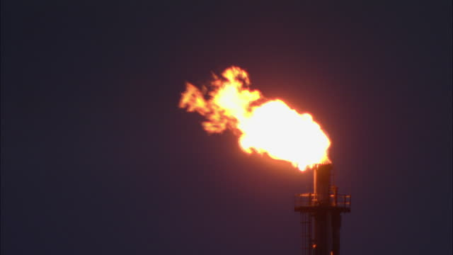 CU, Flare stack burning against sky at dusk, high section, Norway