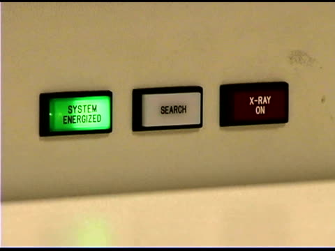 Flashing buttons on airport x-ray machine