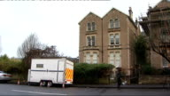 EXT Flat where Joanna Yeates lived police incident vehicle outside Police officers along road Windows of flats where Joanna Yeates lived